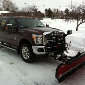 Company truck with snow plow